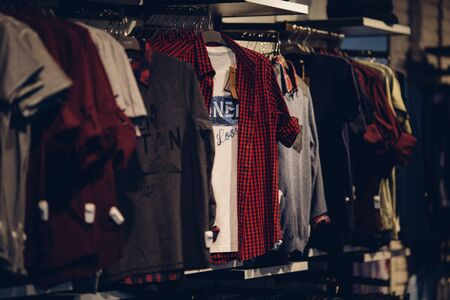 Men clothes store. Youth men's clothing on rack in clothes store