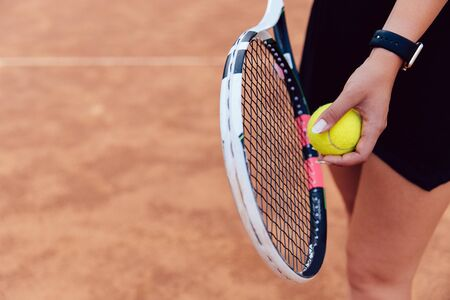 View from above on woman prepares to serve during the match on the tennis court. Banco de Imagens