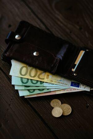 Euro cash inside brown male wallet