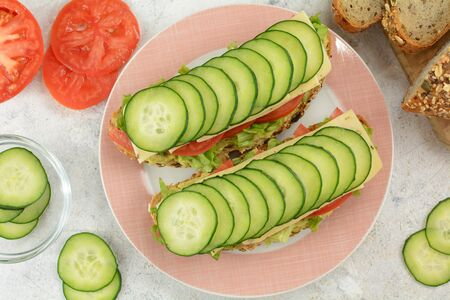 Delicious and Healthy Vegan Jalapeno Cheese Open Sandwich with Whole Grain Bread, Lettuce, Sliced Tomatoes and Cucumbers Stock Photo