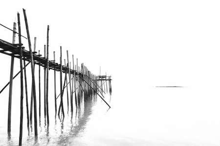 Fisherman jetty in black and white photo
