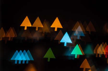 Blurred lights of Kuala Lumpur skyline, arrow shape bokeh photo
