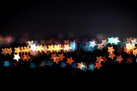 Blurred lights of Kuala Lumpur skyline, star shape bokeh photo