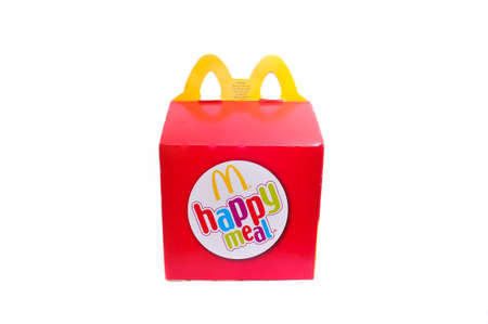 kids meal: KUALA LUMPUR, MALAYSIA - APRIL 22, 2014: McDonalds Happy Meal box for kids on white background. McDonalds is the worlds biggest fast food chain.