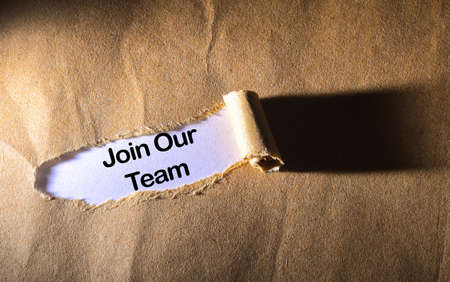 job advertisement: torn paper with word Join our team Stock Photo