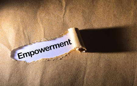 torn paper with word empowerment