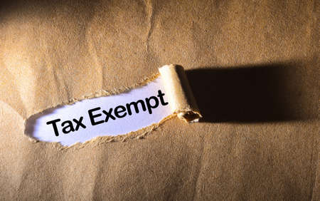 exempt: torn paper with word Tax Exempt