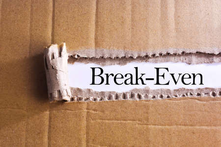 Torn paper box with word Break-even Foto de archivo