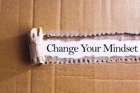 Torn paper box with word Change your mindset
