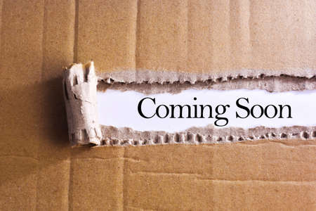 presently: Torn paper box with word Coming soon