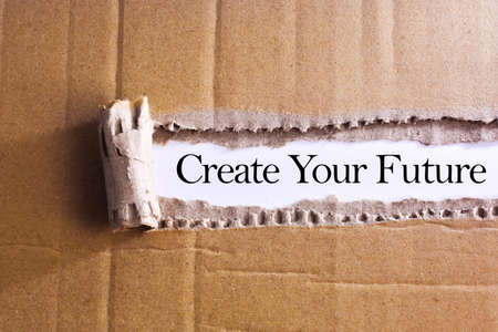 Torn paper box with word Create your future