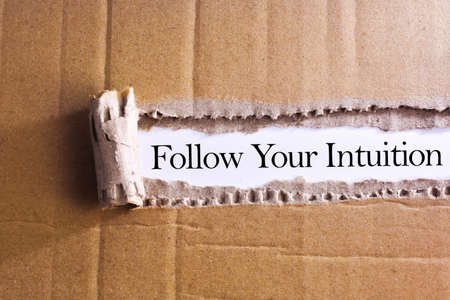 Torn paper box with word Follow your intuition