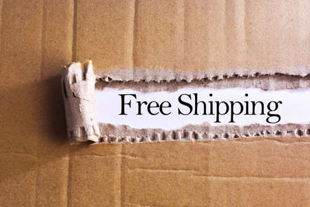 Torn paper box with word Free shipping Archivio Fotografico