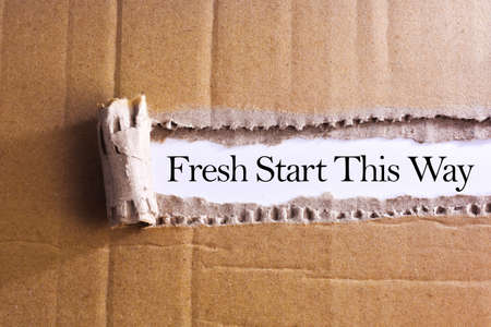 Torn paper box with word Fresh start this way