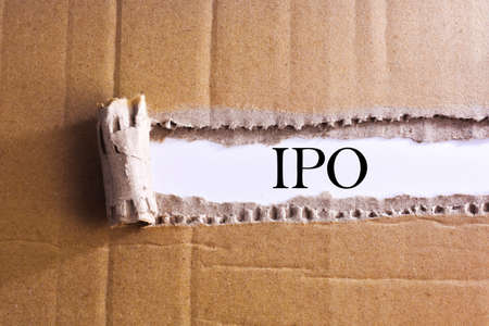 initial public offerings: Torn paper box with word IPO Stock Photo