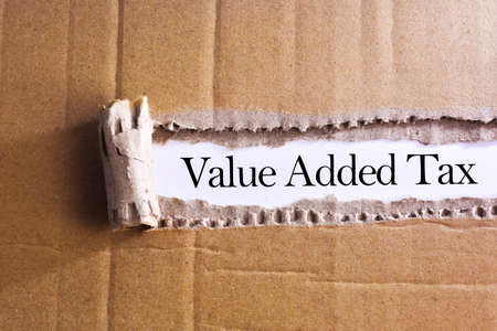 general knowledge: Torn paper box with word Value added tax