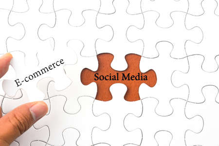 Puzzle with word E-commerce and social media
