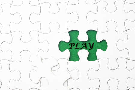 synonym: PLAY word at missing puzzle Stock Photo