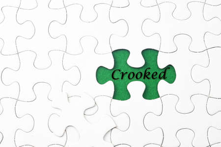 previews: Crooked word at missing puzzle Stock Photo