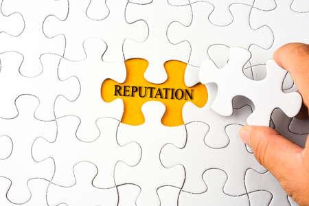 Puzzel met woord REPUTATIE Stockfoto