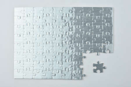 final piece of puzzle: Missing jigsaw puzzle piece red color, business concept for completing the final puzzle piece