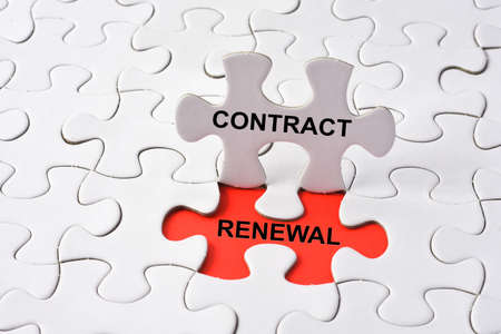 renewal: CONTRACT RENEWAL on missing puzzle Stock Photo