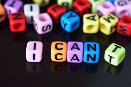 i t: I can self motivation - dropping the letter t of the written word I cant so it says I can Stock Photo