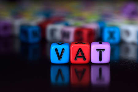 Vat on colorful dice Standard-Bild