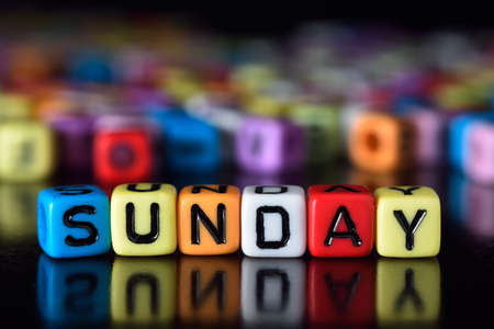 Sunday on colorful dice Stock Photo