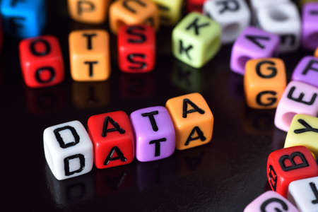 cypher: Data on colorful dice Stock Photo