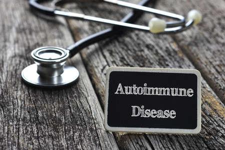 autoimmune: Medical Concept- Autoimmune Disease word written on blackboard with Stethoscope on wood background