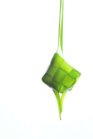 islamic pray: Ketupat (Rice Dumpling). Ketupat is a natural rice casing made from coconut leaf.