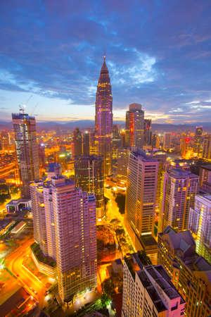 Kuala Lumpur city skyline during sunrise Stock Photo