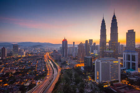 retail scene: Kuala Lumpur city skyline during sunrise Stock Photo
