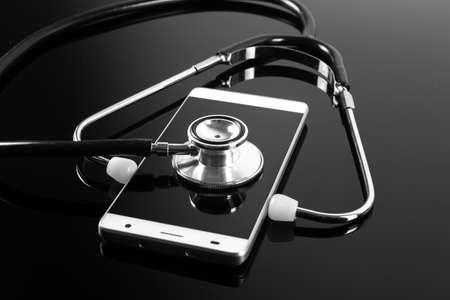 devise: Stethoscope over smartphone screen