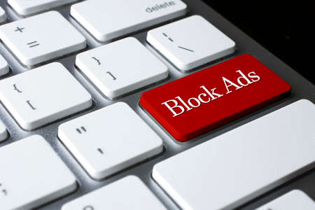 interstitial: Block Ads on Red Enter Button on white keyboard