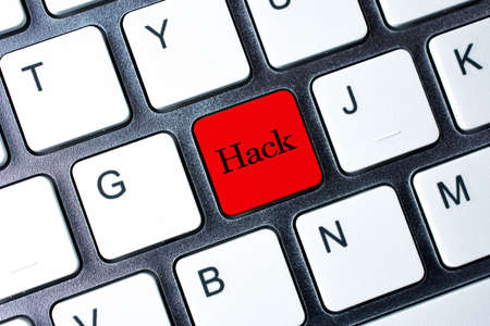 hack: Hack button on white computer keyboard Stock Photo