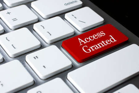 access granted: Safety concept: Access Granted on white keyboard