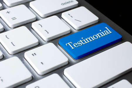 technology agreement: Testimonial on white keyboard