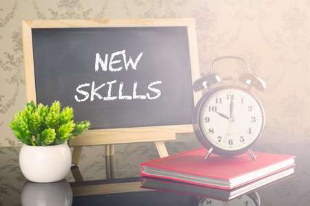 New Skills on blackboard with clock and flare