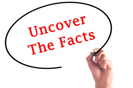 uncover: Hand writing Uncover The Facts on transparent board