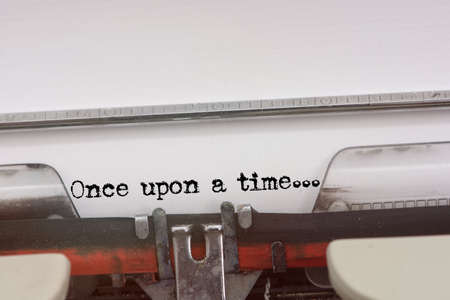 phrase novel:  Once upon a time word typed on a Vintage Typewriter.