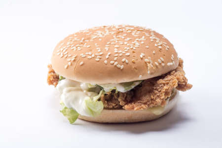 Crispy chicken burger with lettuce, cheese, and mayonnaise Stock Photo