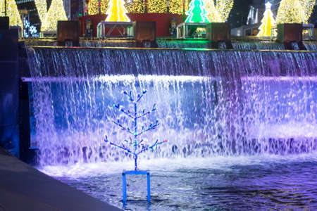Blur image of Cheonggyecheon Stream at night. Cheonggyecheon Stream decorated with colorful lamp for Christmas