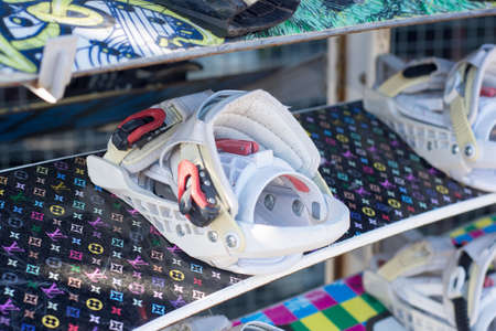 Close up of snowboard with binding with flare