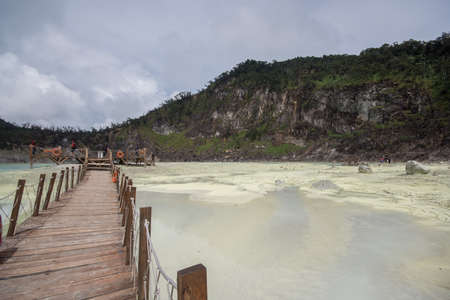 Kawah Putih (English: White Crater) is a striking crater lake and tourist spot in a volcanic crater about 50 km south of Bandung in West Java in Indonesia. Stock Photo