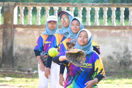 KUALA LUMPUR MALAYSIA,FEBRUARY 25th 2020: Kids plays amateur softball in park. Editoriali