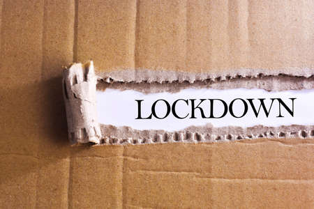 Torn paper box with word LOCKDOWN