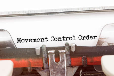 MOVEMENT CONTROL ORDER  word typed on a Vintage Typewriter Archivio Fotografico
