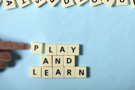 Kid hand competed Play and learn on the puzzle